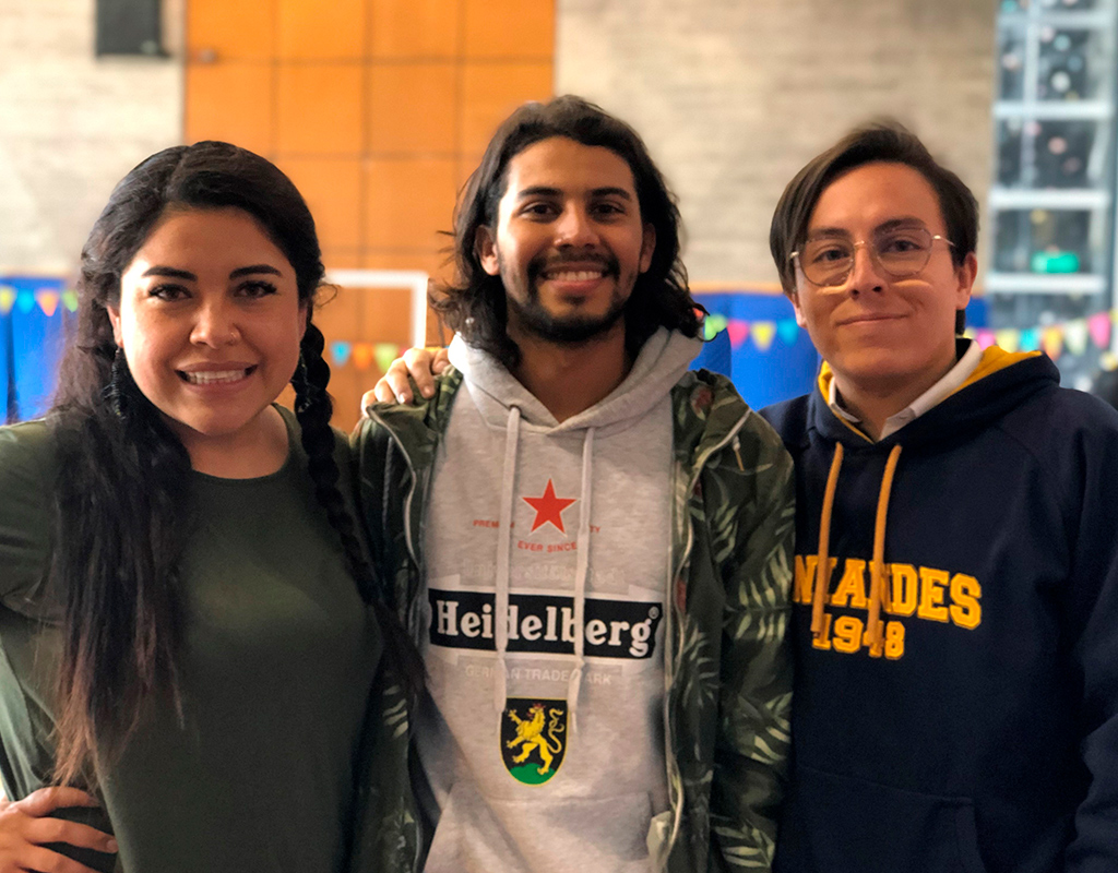 Foto plano medio de María del Pilar Pérez, Jean Paul Bernier (Equipo PLUS) y Juan Sebastián Robayo (CEU), durante la celebración del Día del Voluntario Uniandino 2019.