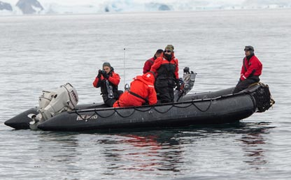 Researchers in a boat at the Antarctic