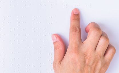 "Hand ""reading"" Braille"