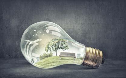 Ilustración de un bombillo con un parque adentro