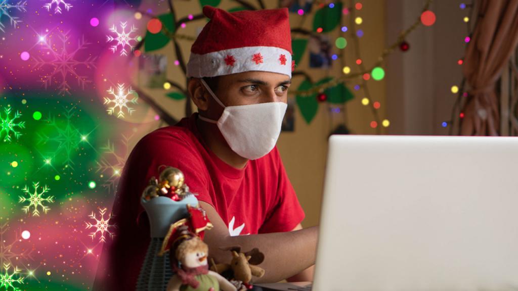 hombre con gorro de navidad y tapabocas