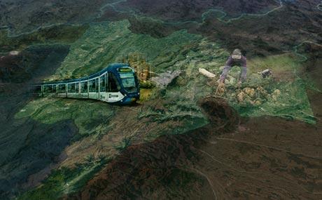 Mapa 3D de Bogotá y Cundinamarca donde aparece un tren de cercanías, edificios y un campesino recogiendo papa.