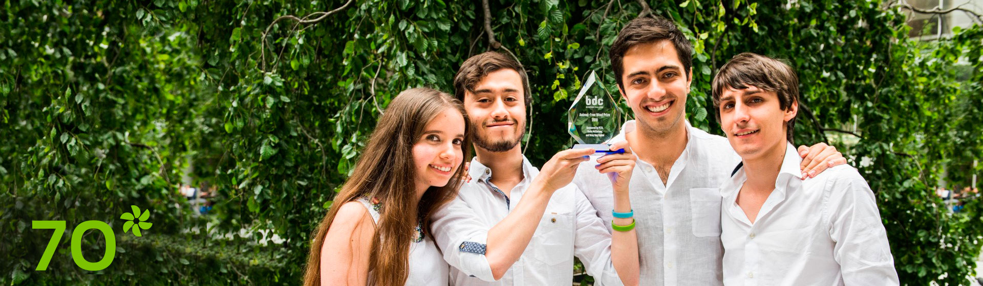 Four design students from Los Andes show the award that they received in New York.