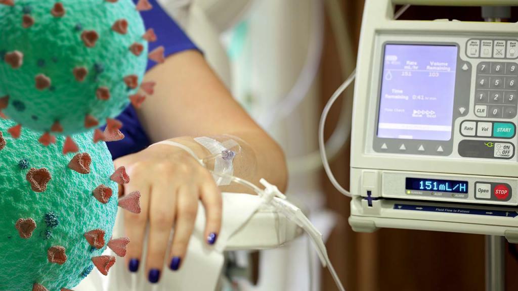 Foto de mano con catéter de goteo intravenoso con una ilustración del COVID