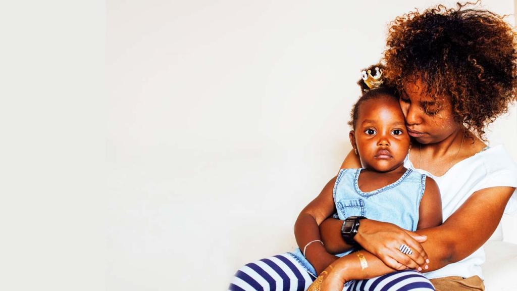 Imagen de mamá afro con su hija