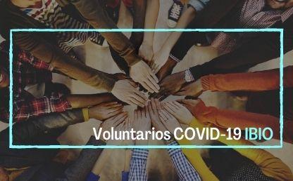 Imagen para la campaña de IBIO COVID19. En el fondo unas manos entrelazadas y el nombre de la campaña
